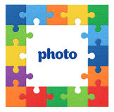 Fond coloré de puzzle de cadre de photo Photos stock