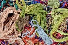 Fond coloré de soie de broderie Images stock