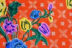 Fond coloré de tissu de tissu de batik Photographie stock libre de droits