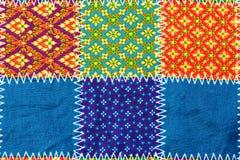 Fond coloré de tissu de tissu de batik photographie stock