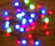Fond coloré lumineux de bokeh de Noël Photographie stock libre de droits