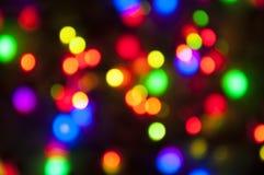 Fond coloré lumineux de bokeh de Noël Image stock