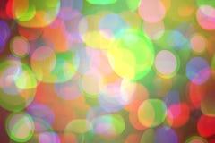 Fond coloré lumineux de bokeh pendant Noël et la nouvelle année Photo libre de droits