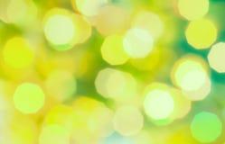 Fond coloré vert et jaune de vacances d'abrégé sur lumière de bokeh de Noël Image stock