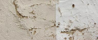 Fond criqué de détail de mur en béton Image stock
