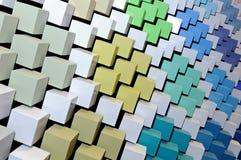 Fond 3D abstrait des cubes multicolores Photographie stock libre de droits