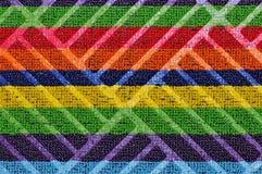 Fond 3D abstrait un textile avec les bandes multicolores Image stock