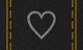 Fond d'asphalte avec le coeur peint Photo libre de droits