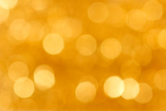 Fond d'or brouillé Photo stock