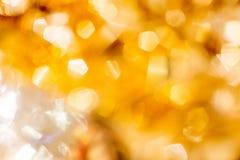 Fond d'or de Bokeh de Noël Scintillement abstrait rougeoyant de vacances d'or Defocused Photographie stock libre de droits