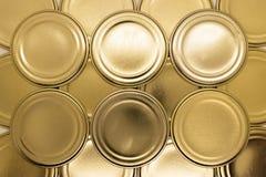 Fond d'or de couvercles de pot photographie stock