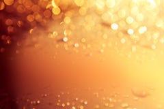Fond d'or de lumières de Noël Image stock