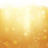 Fond d'or de Noël avec des étoiles et des lumières Images stock
