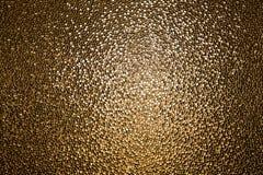 Fond d'or de texture en verre souillé de jaune Photographie stock