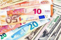 Fond d'euro billets de banque et de dollars américains Photographie stock