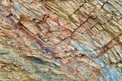 Fond d'image de différentes couches colorées de roche Images libres de droits