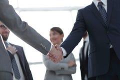 Fond d'image de la poignée de main des gens d'affaires Photos stock