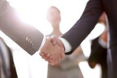 Fond d'image de la poignée de main des gens d'affaires Photo stock