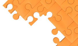 Fond d'isolement orange de puzzle denteux Photographie stock