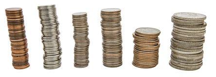 Fond d'isolement par collage de piles de pièces de monnaie Image stock