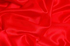 Fond d'un tissu rouge Photographie stock