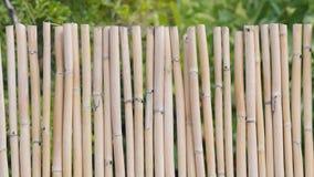 Fond d'une barrière en bambou Photos stock
