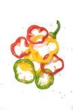Fond de blanc d'isolat de poivrons doux de tranche Photo libre de droits
