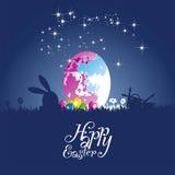 Fond de bleu coloré par lune d'oeufs de lapin de Pâques Photographie stock libre de droits