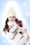 Fond de bleu d'éclaille de neige de fille de l'hiver Photo libre de droits