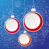 Fond de bleu de label de papier de flocon de neige de babiole de Noël trois Images stock