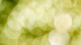 Fond de Bokeh avec les lumières vertes et jaunes defocused Photos libres de droits