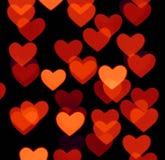Fond de bokeh de coeur, objets troubles de photo, rouge brun sur le noir Photo libre de droits