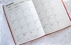 Fond de calendrier de Noël sur des confettis Photographie stock libre de droits