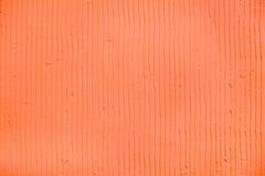 Fond de corail texturisé avec les lignes verticales et les rayures de plâtre photo libre de droits