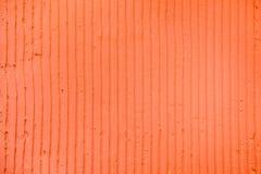 Fond de corail texturisé avec les lignes verticales et les rayures de plâtre photos libres de droits