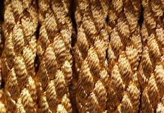 Fond de corde de tresse d'or photos stock