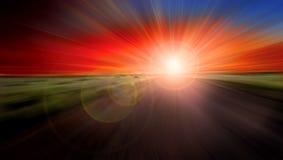 Fond de coucher du soleil de route de vitesse Images stock