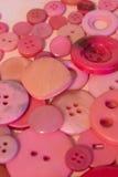 Fond de couture rose de boutons Photographie stock