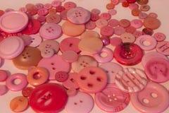 Fond de couture rose de boutons Photos stock