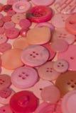 Fond de couture rose de boutons Images stock