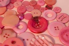 Fond de couture rose de boutons Photo libre de droits