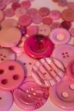 Fond de couture rose de boutons Image libre de droits