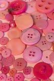 Fond de couture rose de boutons Image stock