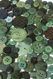 Fond de couture vert de boutons Images stock
