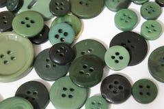 Fond de couture vert de boutons Photo libre de droits
