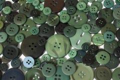 Fond de couture vert de boutons Photographie stock libre de droits