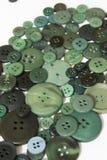 Fond de couture vert de boutons Image stock