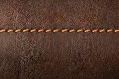 Fond de cuir de Brown avec des coutures Photographie stock