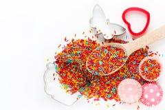 Fond de cuisson avec des ingrédients : sucre coloré arrosant, c Photos stock