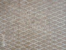 Fond de dalle en béton avec une entaille sous forme de losanges photos libres de droits
